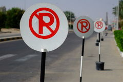 Red and white no parking sign on the road Royalty Free Stock Photo
