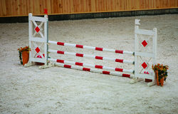 Red white obstacle for jumping horses. Riding competition. Stock Images