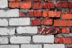 Red and white old worn brick wall with concrete texture background stock image