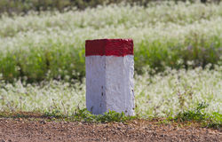 Red and white painted milestones Royalty Free Stock Photography