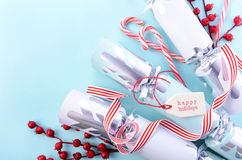 Red, white and pale blue Christmas background. Festive Christmas background with decorated borders of red and white candy canes, bon-bons, berries and Happy royalty free stock photography
