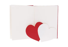 Red and white paper heart on blank open book isolated on white Stock Images