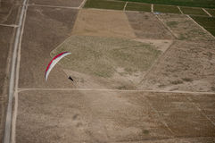 Red and white paraglider Royalty Free Stock Photo