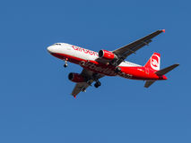 Red and white passenger aircraft Airbus A320 Royalty Free Stock Images