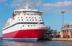 Red and white passenger ferry moored in port Stock Photo