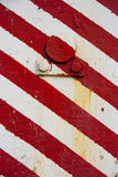 Red white pattern. Closeup, construction site machinery Royalty Free Stock Images