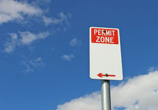 Red and white Permit Zone sign in a bright blue sky Stock Images