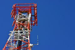 Red and white phone tower. A red and white mobile phone tower Stock Photography