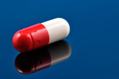 Red and white pill, antibiotic Royalty Free Stock Image