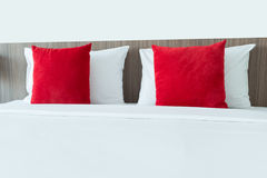 Red and white pillows on a bed.  Royalty Free Stock Photos