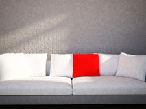 The red and the white  pillows are  on the sofa Stock Image