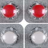 Red and white pills in a blister Stock Image