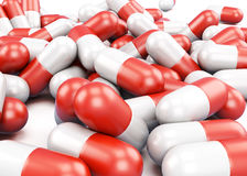 Red and white pills closeup. 3d rendering Stock Images