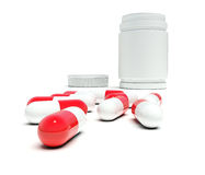 Red-white pills before a white bottle Royalty Free Stock Photography