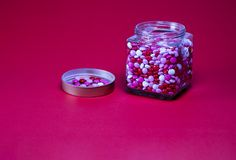 Red white pink round candy on red background royalty free stock images