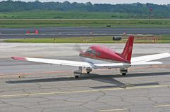 Red and White Plane Parking Stock Photo