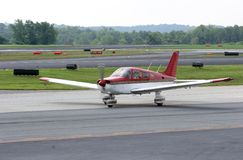 Red and White Plane on Runway Royalty Free Stock Photos