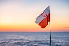 Red and white Polish flag at dusk Stock Photos