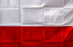 Red and white polish flag. On the wall stock photos