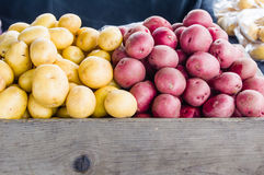 Red and white potatoes at market Stock Photos
