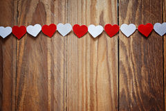 Red and White Ppaper hearts on the clothesline On Royalty Free Stock Images
