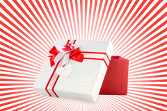 Red and white present wrap by ribbon Royalty Free Stock Photos