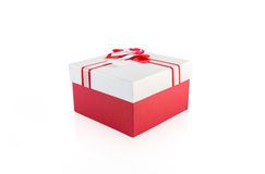 Red and white present wrap by ribbon Stock Image