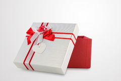 Red and white present wrap by ribbon Royalty Free Stock Images