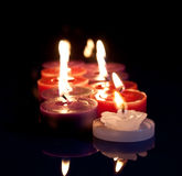 Red, white, purple candles stock images
