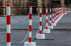 Red white pylons Alerts. Traffic warning Royalty Free Stock Image
