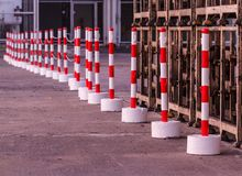 Red white pylons Alerts traffic warning. Outdoors royalty free stock image
