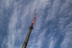 Red And White Radio Tower In Unusual Angle Royalty Free Stock Photos
