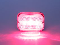 Red and white rear bicycle light Stock Photo