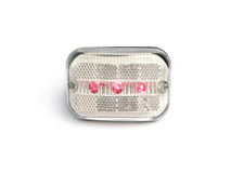 Red and white rear bicycle light Royalty Free Stock Photos