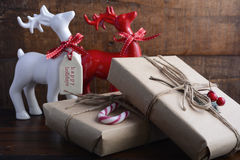 Red and white reindeer ornaments with gifts. Stock Photos
