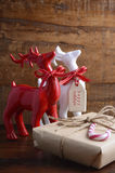 Red and white reindeer ornaments with gifts. Stock Photography