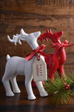 Red and white reindeer ornaments Royalty Free Stock Images