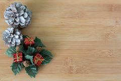 Red and white ribbon on light wood background with Christmas wreath decoration Royalty Free Stock Photos