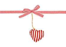 Red the white ribbon in a strip. A bow and the strip heart, isolated on white background Royalty Free Stock Photos
