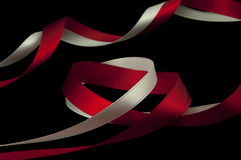 Red and White ribbons. Isolated on black Stock Image