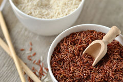 Red and white rice. In bowls Stock Photo