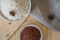 Red and white rice with spices. Raw asian rice Stock Image