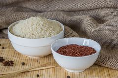 Red and white rice with spices. Raw asian rice Stock Images
