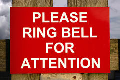 Red and white ring bell sign Stock Images