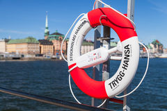 Red and white ring buoy in Stockholm Stock Photos