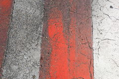 Red and white road marking on old asphalt road Stock Photos
