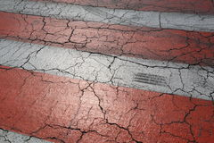 Red and white road marking on old asphalt road Royalty Free Stock Photography