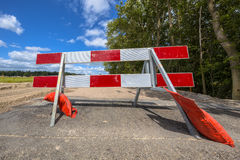 Red and white roadblock in perpective Stock Image