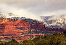 Red White Rock Canyon Snow Clouds Sedona Arizona. Boynton Red White Rock Canyon Snow Clouds Green Trees Forest Sedona Arizona Stock Images
