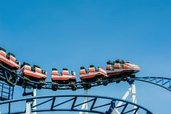 Red and White Roller Coaster on Railings Stock Images